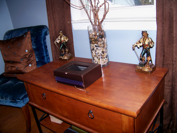 Fabulous Relaxing Brown & Blue Office, This room was blue when I moved in. I painted it hot pink!! The pink was different but it hurt my head after a while. SO back to blue, but a better blue. I painted the ceiling dark brown partly as an experiment to see if I would like it, and partly to hide the imperfections, cracks, bumps, and glued on stars!!! Turns out, I do love a brown ceiling and have since painted the bedroom ceiling and will soon paint the bathroom. Anyone thinking about painting a ceiling dark brown....don't be afraid!! Although I must say, I think white crown molding is a must in such an endeavor. So anyway, this is my favorite room so far but I am open to any suggestions you may have. Several minds are better than one., The Armor Bronze pirates you see here were my initial inspiration for the color scheme of the room. Purchase by my wonderful husband, they just didn't feel comfortable in the pink room!!!    , Home Offices Design