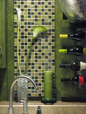 Small Basement Kitchen, This is a basement laundry room area that is also a kitchen. A new kitchen sink was recently installed and I then put up wall board, tiles, wine rack and storage areas. I gave the wall a colorful paint treatment and made unique graphic pantry doors. They are on the right side of the photo. The multi green tiles tie all the colors together., These multi colored glass tiles of greens and browns help tie all the colors together. , Basements Design