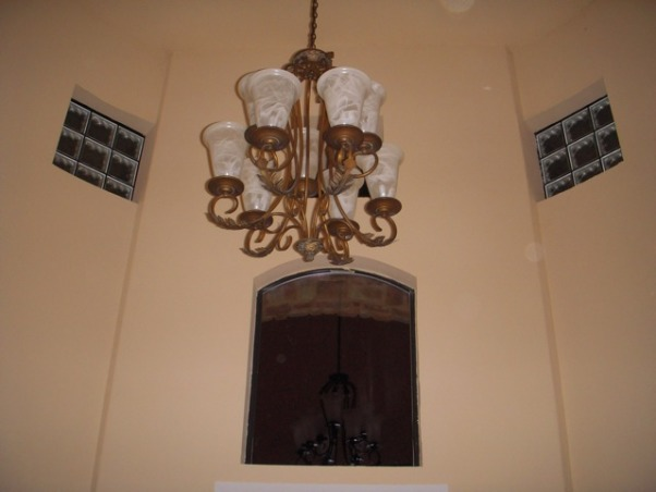 "HELP FILL MY NICHE & ROUND TUSCAN FOYER, This is a 12 foot ROUND foyer with 20 foot tower ceiling. The wall either side the entry door is flat but then is rounded on either side as you enter the house. There is a 4' curved wall to the left of the front door, then an 8' tall arched closet door, then another 6' curved wall. To the right, there is a 4' curved wall, then a niche that is 56"" tall starting 30"" from the floor, after that there is another 4' curved wall. I DON'T KNOW WHAT TO DO WITH THESE CURVED WALLS AND THIS HUGE NICHE - HELP, This is a shot of the foyer ceiling it is at least 20 feet high. All curved walls go up 20' high   , Other Spaces Design"