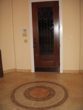 "HELP FILL MY NICHE & ROUND TUSCAN FOYER, This is a 12 foot ROUND foyer with 20 foot tower ceiling. The wall either side the entry door is flat but then is rounded on either side as you enter the house. There is a 4' curved wall to the left of the front door, then an 8' tall arched closet door, then another 6' curved wall. To the right, there is a 4' curved wall, then a niche that is 56"" tall starting 30"" from the floor, after that there is another 4' curved wall. I DON'T KNOW WHAT TO DO WITH THESE CURVED WALLS AND THIS HUGE NICHE - HELP, this is a shot from inside the foyer to the front door. This is the only place where there are flat walls and they only extend about 20"" on either side of the door.  , Other Spaces Design"