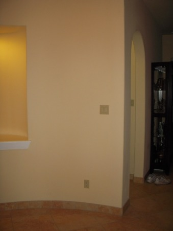 "HELP FILL MY NICHE & ROUND TUSCAN FOYER, This is a 12 foot ROUND foyer with 20 foot tower ceiling. The wall either side the entry door is flat but then is rounded on either side as you enter the house. There is a 4' curved wall to the left of the front door, then an 8' tall arched closet door, then another 6' curved wall. To the right, there is a 4' curved wall, then a niche that is 56"" tall starting 30"" from the floor, after that there is another 4' curved wall. I DON'T KNOW WHAT TO DO WITH THESE CURVED WALLS AND THIS HUGE NICHE - HELP, This is the last curved wall to the left as you enter the foyer and it faces you as you enter. It measures 4' to the edge past the niche.  , Other Spaces Design"