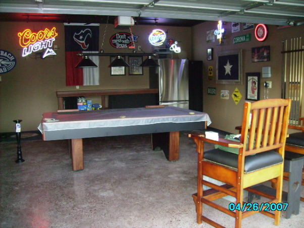 Garage Game Room, Our house didn't have a game room, so we made our garage into one., our new garage  we had the floor polished to look like marble, painted the ceiling black and the walls brown, added black baseboards and voila a new room!!!, Garages Design