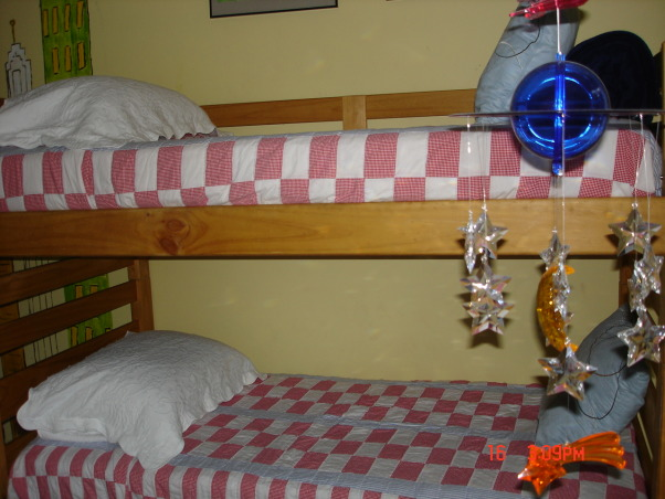 My grandsons' room, small space needs to accommodate 3 boys so, bunk beds and daybed with big TV just because they like it, My grandsons'room with bunk beds and red,blue and white quilts by Ralph Lauren., Boys' Rooms Design