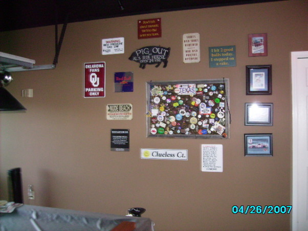 Garage Game Room, Our house didn't have a game room, so we made our garage into one., other pictures we hung as well as my pin and button collection, Garages Design