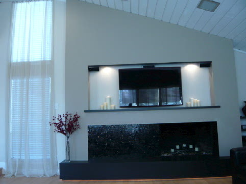 Modern Living, I have created a modern living space with clean lines and a custom designed fireplace. The fireplace includes a back-lit, floating hearth, mosaic tiles, and an insert for the LCD television with down lighting., Modern living space designed around a custom designed fireplace.  , Living Rooms Design