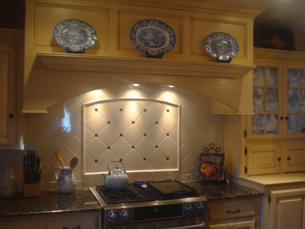 French Country Blue and Yellow Kitchen, This kitchen re-do was the 2nd in two years.  When we first did the remodel, we just painted all the cabinets white, but it never really made me happy.  I went bold with yellow cabinets and a blue island, and the new colors work MUCH better with our very rustic saltillo tiles. , Same cooktop area after.  Widened the hood area, added gas, added proper ventilation, and had a hutch built where the fridge used to be.  , Kitchens Design