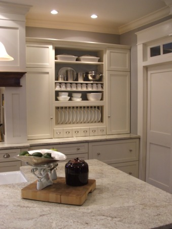 The look for a lot less-before & after, transitional kitchen style.  i spent a lot of time pricing and revising plan to achieve a custom kitchen look without the price tag.  because i love to cook but hate to clean, function was just as important as aesthetics.  behind pocket door (left of ovens) is my pantry with custom looking cabinets and wood countertops (home depot unfinished cabinets w/ trim molding added and salvaged wood countertops) w/ built-in microwave and prep sink. (photos to come- need to paint cabs), I find putting dishes in cabinets a waste of time. So my dish washer is located on island in front of open shelves to make clean up a breeze.  My prep pantry is located thru pocket door to left. love to be able to close a workspace off from guests view.  I have a fobia of typical one door base cabinets, I may not have alot of cabinets but they are all large fully extendable drawers (so large my baby's bath tub and supplies fits in one and because we remodeled most of our house, the local supplier ordered our drawers with the soft close feature for free. (Shout out to R&P Lumber, Waterloo, IL               , Kitchens Design