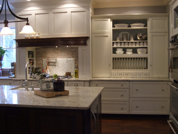The look for a lot less-before & after, transitional kitchen style.  i spent a lot of time pricing and revising plan to achieve a custom kitchen look without the price tag.  because i love to cook but hate to clean, function was just as important as aesthetics.  behind pocket door (left of ovens) is my pantry with custom looking cabinets and wood countertops (home depot unfinished cabinets w/ trim molding added and salvaged wood countertops) w/ built-in microwave and prep sink. (photos to come- need to paint cabs), We remodeled our kitchen on a very tight budget. my husband worked his magic to get a great price on our granite. the island granite is 4'x9' (fun watching it get installed  My island holds apron front farm sink, dish washer, water heater (we have well water system beverage refrigerator, and my favorite- roll out trash cabinet next to sink.(a must have!  and of course most importantly seating for 4-5 people. I love my granite countertops, i wanted marble but too porous, not good with maintenance. so was going to use quartz or composite counter from home depot, but was more expensive than granite. I am still looking for a better island light fixture, bought online cheap to make husband happy, thinking about designing and building hanging pot rack/ lighting with old barn timber and stainless steel. What do you think?                 , Kitchens Design
