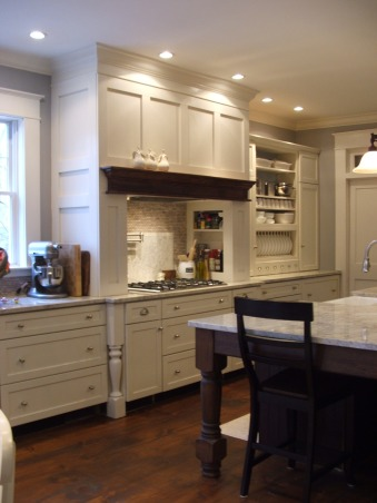 The look for a lot less-before & after, transitional kitchen style.  i spent a lot of time pricing and revising plan to achieve a custom kitchen look without the price tag.  because i love to cook but hate to clean, function was just as important as aesthetics.  behind pocket door (left of ovens) is my pantry with custom looking cabinets and wood countertops (home depot unfinished cabinets w/ trim molding added and salvaged wood countertops) w/ built-in microwave and prep sink. (photos to come- need to paint cabs), After... I love the look of furniture as cabinets. the legs on island and cook area where purchased unfinished online for cheap, vs. $600 ea. thru cabinet manuf.  Still have base trim to add to wall of drawers to give look of furniture.               , Kitchens Design
