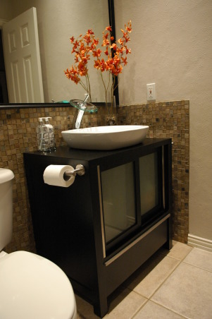 "Small Bath Oasis Transformation, Our ""basic builder"" bathroom previously consisted of a 5x8 space with your basic, boring white vanity, white tub, and white cheap-o tile, and boring wall paper.  We were inspired by several of the bathrooms we saw on this website plus many HGTV shows that gave us the inspiration we needed.  We wanted a contemporary spa feel with modern amenities.  Although our space is small we took advantage of the high 9' ceiling by running the tile all the way to the ceiling and installing 4"" recessed lighting.  This really draws your eye up!  We used 18x18 tiles on the wall, 6x6 on the shower floor, and a great 1"" tile around the vanity and toilet.  It's actually a mix of glass tile and slate.  The vanity, sink, and faucet were purchased on-line and the mirror was cut locally to fit the exact space.  We are thrilled at the transformation and can't believe how much bigger our 5x8 space now appears!  ADDED INFO-- Thank you all for the kind comments, we are amazed at the feedback!  Thank You!  Several questions have been asked about the cost and materials, so here's the info....  COST-- We loved the comment about estimating the cost at $40,000.  Actually, it cost $8,000 for everything.    DESIGNER-- Someone asked if we hired a professional designer.  Nope.  We are addicted to HGTV and picked up lots of tips and ideas from the show (esp. Candice, Vern, Angelo and David Bromstad) and this website.  We purchased all of the materials ourselves.  We did some of the work ourselves and hired a great contractor for the tough stuff.  FAUCET-- Purchased at ExpressDecor.com for $139  VANITY-- It's a Decolav vanity (5510-ES) that includes the sink.  EveryVesselSink.com for $900  TILE-- All purchased at Expo (Isn't it a shame that they are all closing!).  1x1 Glass Tile/Slate were the most expensive of all of the materials!  $32/sf.  From Oceanside Glass Tile (glasstile.com) it's Geologie High Desert.  The 18x18 shower wall tile is from Daltile (5202 Golddust) @ $2/sf.  The 6x6 shower floor tile is CTI Tile (Rex Shabui, Charcoal Black).  MIRROR- cut locally and custom frame from Aaron Brothers.  PAINT--  Sherwin-Williams (SW6078 Realist Beige).  Thanks again for all of the kind remarks!  If we can do it-- so can you!, Contemporary Vanity/ Sink from Decolav             , Bathrooms"