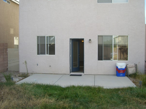 Bland Backyard, Just bought our first home and it has your typical boring tract home feel.  Although it's landscaped, it's not done well.  Want to add a patio covering and more privacy (we can see into the neighbors kitchen!!).  I would love like a mediterranean or moroccan lounge-like escape. Oh and it's Las Vegas-so would like desert friendly yard!!  Rate this so we can get on the show!!! :), want to add a pergola type patio , Patios & Decks Design