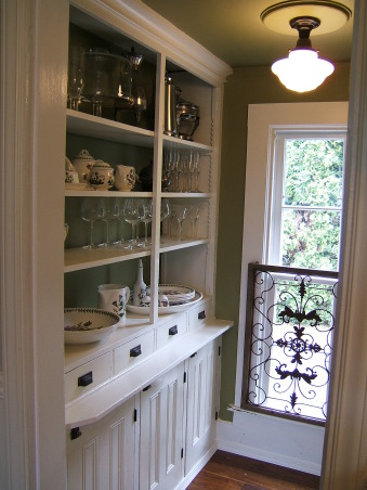 "J.S. White House Butler's Pantry, I didn't change too much in this butler's pantry other than removing red/white checkerboard wallpaper and painting the walls with Devine Paint ""Green Tea"" and adding a granite counter. The counter was previously cracked, white 4x4 tiles. The hardware on the left (drawers) is original and I matched reproduction hardware for the cabinet doors from House of Antique Hardware. The floor is handscraped Teak wood from Lumber Liquidators.  , Dishes are a collection of antique silver and Portmeirion ""The Botanic Garden"".  Hardware on the drawers are original but I purchased reproduction hardware that matches from House of Antique Hardware.   , Kitchens Design"