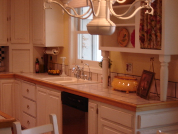 French country, Kitchen in pale yellow with white cabinets.Hardwood floors., French country kitchen with pale yellow walls and white wood cabinets tile framed in wood., Kitchens Design