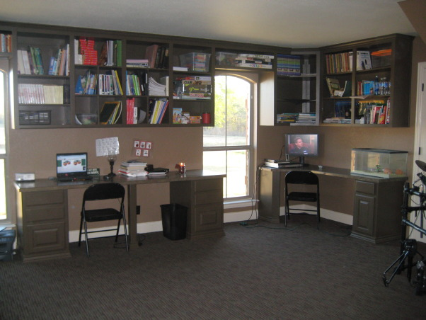 Homeschool Room Office, We converted our garage into a homeschool room. We have 4 children whom we have home all the time so we needed practical dark and useful., Other Spaces Design
