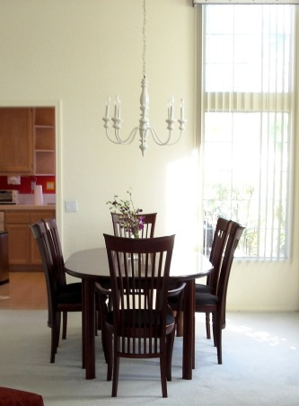 """Dine on a Dime"" Living/Dining B&A's, This dining room was white and lifeless before. Inexpensive changes really dressed it up., BEFORE-The space was white and dull with its lack of color and dated chandelier.   , Dining Rooms"