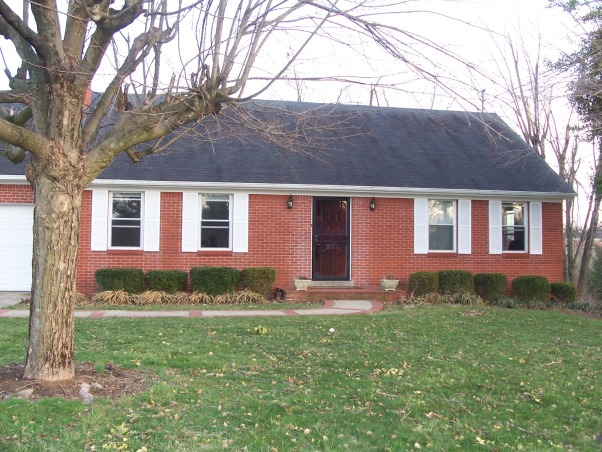 Ugly Brick Ranch Needs Facelift, 1950s red brick ranch wants to move into the 21st century..please help  , closer look.It appears as if the previous owners painted the trim and it rained so there is paint on the brick.  How can we get it off? they were also sloppy painting the trim so there is paints drips and mistakes around the trim. , Home Exterior Design