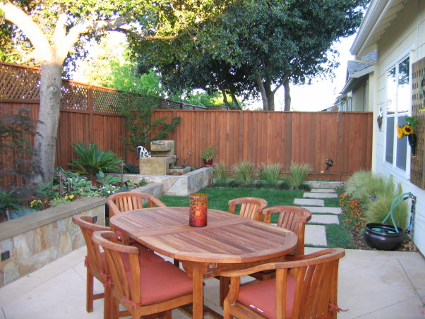 Outdoor Kitchen and Eating Area, Our backyard is small (21x52) and we made the most out of the space we have.   We love to sit outside with a glass of wine and enjoy the evening., Dining area = West Teak table with hidden leafs - opens to seat 10 comfortably             , Outdoor Spaces