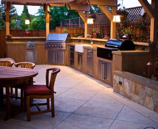 Outdoor Kitchen and Eating Area, Our backyard is small (21x52) and we made the most out of the space we have.   We love to sit outside with a glass of wine and enjoy the evening., Patio is colored concrete.  Beware of colored concrete, because it has a higher tendency to crack when drying.  Ours cracked a lot so I have had to hide it with an outdoor rug.  , Outdoor Spaces