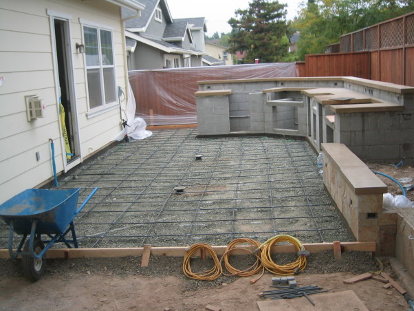 Outdoor Kitchen and Eating Area, Our backyard is small (21x52) and we made the most out of the space we have.   We love to sit outside with a glass of wine and enjoy the evening., Patio before pouring     , Outdoor Spaces