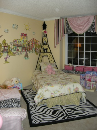 Diva Paris zebra room, We made an Eiffel tower headboard with shelves to utilize the corner placement of her bed. Black pom poms were a big inspiration for this room. they are around the bed,Eiffel tower, lamp shade and curtains., Girls' Rooms Design