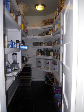"Something's Gotta Give Inspired Kitchen, We built what was supposed to be our ""dream house"" in 2006-07, but I was designing the kitchen in my mind for years before that. I won't go into the gory details, but suffice to say we had a LOT of problems, many still outstanding, and it's likely the house may never be worth what we ended up paying for it, thanks to a crooked/incompetent contractor and other woes.   On the bright side, though it's not perfect, it's still pretty comfy, especially if you don't look too closely, and it's a lot nicer than any house I ever thought I'd live in, even in my wildest imagination. It wasn't that long ago that I was making Thanksgiving dinner for 12 in a tiny apartment with a 20-year-old coil top stove and 3 sq. inches of counter space, so I do know how very, very lucky I am.  I did all the design, from basic floor plan to decorating, myself, so blame me if you hate it. And, no, not everything is exactly as I'd like it, but the money tree didn't take root, so I work with what I have, including a lot of flat pack furniture. I was inspired by, among other things, the Hampton's beach house in the movie Something's Gotta Give, even though we're nowhere near the water, unfortunately. I guess I'd call my overall ""look"" cottage beach house via Pottery Barn.  To answer the most frequently asked question ... I'm an avid cook and baker and often feed a crowd so, yes, I really do use all those ovens. There are five, in case you're counting: two electric, one gas, a convection/steam oven and an Advantium.  Thanks to all who have taken the time to share comments, and a special thank you for all those folks who shared their own kitchen pictures, many of which inspired me. I am just trying to return the favor.  If you're interested in additional details and more photos, of the whole house, actually, you can go to: http://susanandmarkw.shutterfly.com, large, walk-in pantry (approx. 7x12) with swinging door; my pride and joy                    , Kitchens Design"