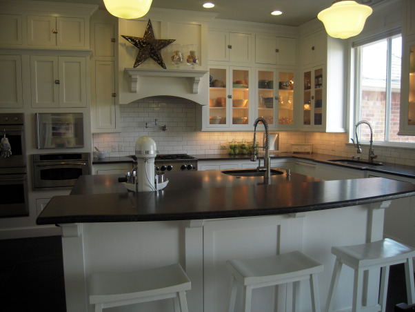 "Something's Gotta Give Inspired Kitchen, We built what was supposed to be our ""dream house"" in 2006-07, but I was designing the kitchen in my mind for years before that. I won't go into the gory details, but suffice to say we had a LOT of problems, many still outstanding, and it's likely the house may never be worth what we ended up paying for it, thanks to a crooked/incompetent contractor and other woes.   On the bright side, though it's not perfect, it's still pretty comfy, especially if you don't look too closely, and it's a lot nicer than any house I ever thought I'd live in, even in my wildest imagination. It wasn't that long ago that I was making Thanksgiving dinner for 12 in a tiny apartment with a 20-year-old coil top stove and 3 sq. inches of counter space, so I do know how very, very lucky I am.  I did all the design, from basic floor plan to decorating, myself, so blame me if you hate it. And, no, not everything is exactly as I'd like it, but the money tree didn't take root, so I work with what I have, including a lot of flat pack furniture. I was inspired by, among other things, the Hampton's beach house in the movie Something's Gotta Give, even though we're nowhere near the water, unfortunately. I guess I'd call my overall ""look"" cottage beach house via Pottery Barn.  To answer the most frequently asked question ... I'm an avid cook and baker and often feed a crowd so, yes, I really do use all those ovens. There are five, in case you're counting: two electric, one gas, a convection/steam oven and an Advantium.  Thanks to all who have taken the time to share comments, and a special thank you for all those folks who shared their own kitchen pictures, many of which inspired me. I am just trying to return the favor.  If you're interested in additional details and more photos, of the whole house, actually, you can go to: http://susanandmarkw.shutterfly.com, island seating area                              , Kitchens Design"