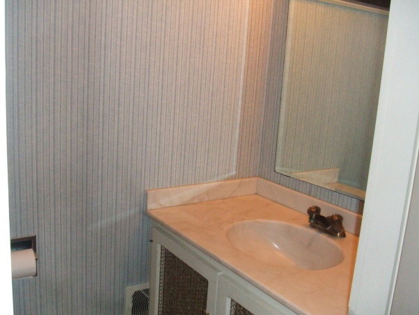 "Sleek, modern, small bathroom, I updated a small and very outdated half bathroom.  I installed glass tile, glass vanity, glass sink, and glass faucet to create very airy feel.  I ran the tiles (subway pattern) verticaly to elongate the room.  I used the same tile on floor and wall to create illusion of length., The dreaded ""before"" (1 of 2)         , Bathrooms Design"