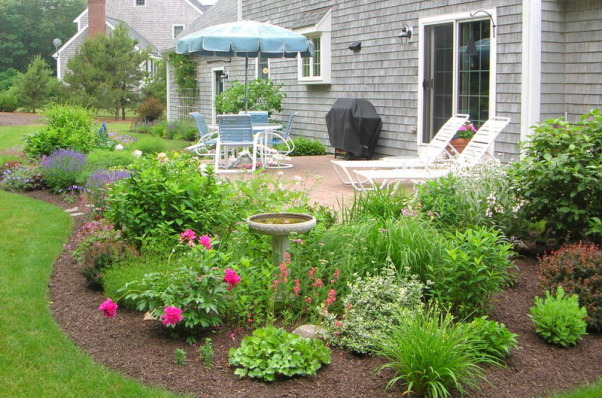 Simple patio with perennials, My husband built this raised patio about six years ago, and I had the fun of adding the perennial garden from scratch.  I've included photos that show the patio from various angles as well as the plantings during different months of the summer  (which doesn't last very long here in coastal New England!), Patios & Decks Design