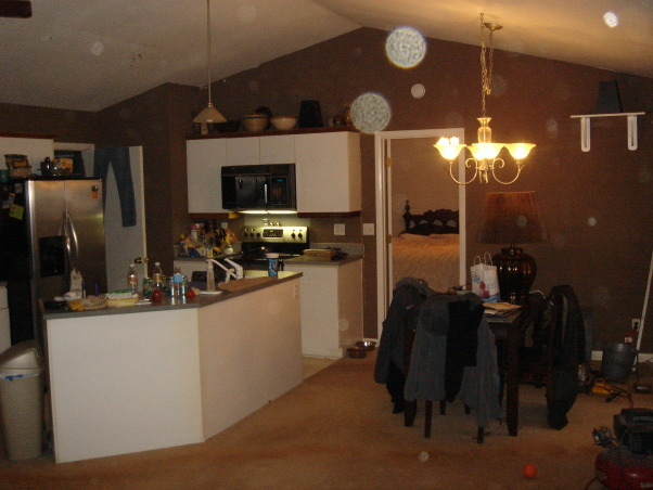 "Living / Kitchen / Dining Room, Before and After Renovation shots of our Kitchen/Living/Dining Room.  Some of the before photos are a wreck, but they were taken while some other areas of the renovation had arleady begun. The place was truly a mess and we lived there during the whole process. It was 5 months of living in a spare room and taking the dog outside on a leash to pee, but it was worth it.  A friend pointed out that we neglected to mention that we added about 15 feet off the back of the house to get this amazing room. You can see it on our exterior house pictures., Kitchen Area Before Renovation  These ""Before"" photos are a mess I know, renovation had already been going on, and I took some pictures and did not clean up, we were moving things out and things were moved all around about then.     , Living Rooms Design"