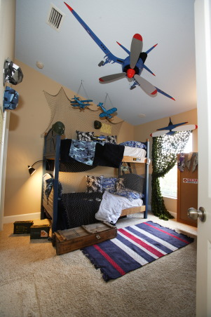 Boy's Military Room, I used items purchased from the army surplus store to add a unique and realistic look to this fun boy's room., Boys room - cieling fan made to look like plane propellers, missile boxes used for storage, camoflague netting purchased at army surplus store for window treatments, hats and other surplus items purchased cheap at supply stores as well. , Boys' Rooms Design