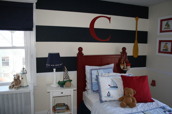 Conner's Nautical Boys Room, We had so much fun creating this space for our 3 yr old son. My husband painted vertical stripes on the wall and we added a C from Wallwords above the bed. The bedding and roman shades are from Pottery Barn kids. , We painted navy horizontale stripes on the cream walls that were already painted and added a C from wallwords. The white nightstand is from IKEA.  , Boys' Rooms Design