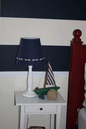 Conner's Nautical Boys Room, We had so much fun creating this space for our 3 yr old son. My husband painted vertical stripes on the wall and we added a C from Wallwords above the bed. The bedding and roman shades are from Pottery Barn kids. , The lampshades and lights are from Pottery Barn kids as well as the sailboat which I found on eBay. I also added some more nautical decor that I found at Target and Michaels.  , Boys' Rooms Design