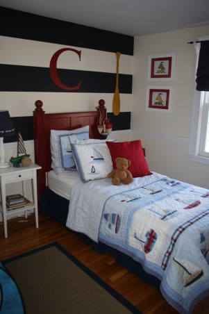 Conner's Nautical Boys Room, We had so much fun creating this space for our 3 yr old son. My husband painted vertical stripes on the wall and we added a C from Wallwords above the bed. The bedding and roman shades are from Pottery Barn kids. , The headboard is from Pottery Barn Kids as well as the bedding.  , Boys' Rooms Design