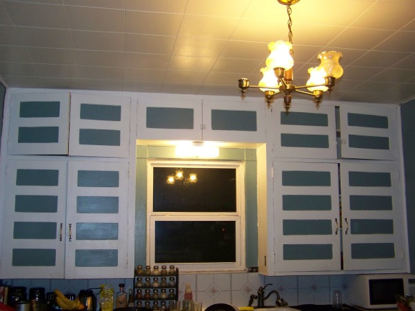 early 1900's kitchen, DOes anyone have any idea how i could update my cabinets on a tight budget? my home was built around 1905 and i dont belevie that the kitchen has ever been updated. except for the paint on the cabinets and wall paneling. there are also about 3 layers of vinal on the floor. Its a large room but the space has not been use well. there are only cabinets on 1 wall., my dated kitchen , Kitchens Design