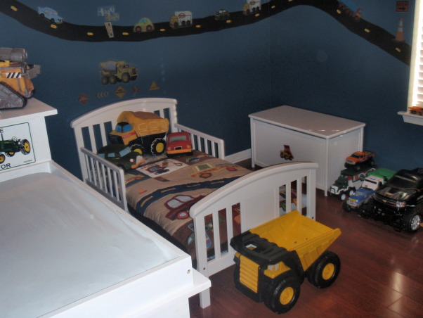 Toddler boy room, My son loves trucks & cars of all kinds..so I hand painted the road on the wall then used stickers to decorate. The bedding has a construction truck theme and I also used road signs and a construction hat to decorate the walls., Toddler room , Boys' Rooms Design