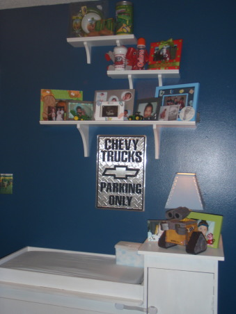 Toddler boy room, My son loves trucks & cars of all kinds..so I hand painted the road on the wall then used stickers to decorate. The bedding has a construction truck theme and I also used road signs and a construction hat to decorate the walls., Shelves over the changing table , Boys' Rooms Design