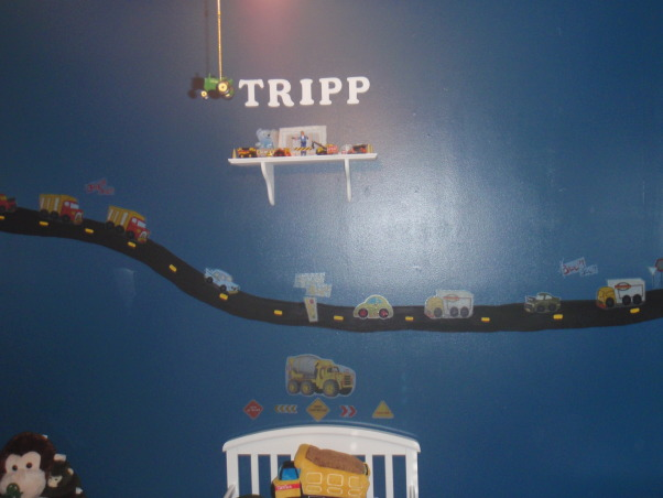 Toddler boy room, My son loves trucks & cars of all kinds..so I hand painted the road on the wall then used stickers to decorate. The bedding has a construction truck theme and I also used road signs and a construction hat to decorate the walls., Boys' Rooms Design