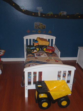 Toddler boy room, My son loves trucks & cars of all kinds..so I hand painted the road on the wall then used stickers to decorate. The bedding has a construction truck theme and I also used road signs and a construction hat to decorate the walls., Toddler bed , Boys' Rooms Design