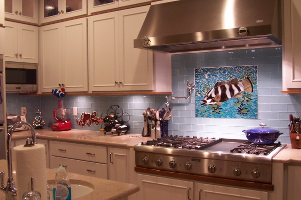 My Beachy Kitchen, My kitchen/Great Room is wonderful, I love to cook so it has plenty of space and great appliances.  Eco friendly it has FSC solid Teak floors, quartz counters, recycled glass backsplash and energy star appliances and lighting. My friend did the glass mosaics and husband & friend the teak bartop and trim. Cabinets are painted maple-yes it is bright, but I love it!, The grouper mosaic my friend Julie made! There is a red octopus to the left... , Kitchens Design