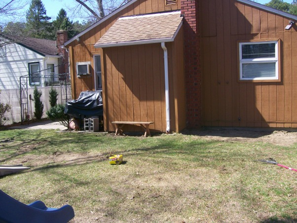 Please Help My Yard, As you can see we need help!  Here are pictures of my back and side yards.  We have an old cottage and no front door or back door, there is a door on each side of the house. With the deck and patio being on the side of the house thats where people usually gather but it's tight. I want to make the back yard inviting and relaxing to be in. Money is tight in these times and we do want to do the work on our own so we're looking for inexpensive projects. I'm sure you all will come up with ideas that we're just not thinking of!  Thank you!!, This is where we put the kids pool. Close to the house on the right side of this picture., Yards Design