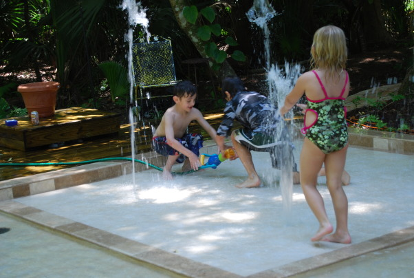 Our Backyard Water Park!, My husband and I wanted something unique and fun for our kids. We also wanted it to look mature. We have seen these types of water parks around Florida. We wanted our own private one. My husband designed and put together this. We went with travertine tiles and ceramic tiles. Everybody loves coming over to enjoy our backyard water park!, Our back yard water park! Our kids and their friends just love it!             , Yards Design