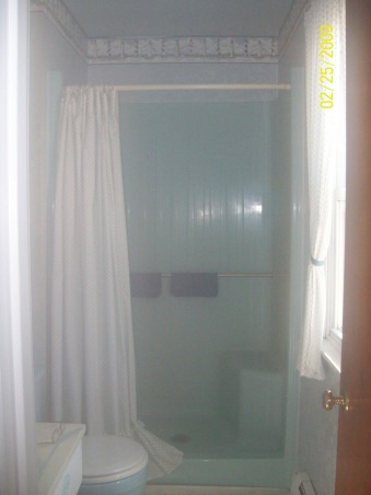 Hubby's small bathroom, Small 3/4 bath..Went from light blue to chocolate brown, Old shower which I kept , Bathrooms Design