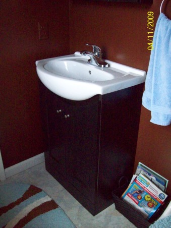 """Hubby's small bathroom, Small 3/4 bath..Went from light blue to chocolate brown, New black vanity with white sink.  Replaced the linoleum with self stick """"seashell"""" tiles , Bathrooms Design"""