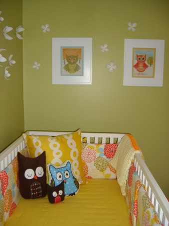 fun and fresh owl inspired nursery, I wanted a room that felt open and airy and fresh and colorful.  I love owls and used them sprinkled throughout to add character and color.  The room is for our baby girl due in June and I think it's perfect for a little girl, but not overly girly.  The crib and changing table is Amy Coe brand from Babies R Us.  The chair is from IKEA.  The bedding was fabric I had from a duvet cover and I hired someone on the site Etsy to make it.  I loved how it turned out.  My mom made the cute window valance and my husband made the little owl artwork.  Let me know what you think!, Bedding was custom made from a seamstress found on Etsy.  Little stuffed owls are also from Etsy.  Gorgeous blanket made by a friend of my moms., Nurseries Design