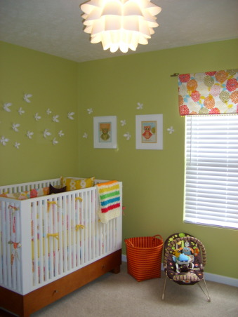 fun and fresh owl inspired nursery, I wanted a room that felt open and airy and fresh and colorful.  I love owls and used them sprinkled throughout to add character and color.  The room is for our baby girl due in June and I think it's perfect for a little girl, but not overly girly.  The crib and changing table is Amy Coe brand from Babies R Us.  The chair is from IKEA.  The bedding was fabric I had from a duvet cover and I hired someone on the site Etsy to make it.  I loved how it turned out.  My mom made the cute window valance and my husband made the little owl artwork.  Let me know what you think!, Crib is Amy Coe Brand from Babies R Us.  Wall flowers are from Urban Outfitters.  Floor basket from Land of Nod.  Owl Prints are designed by my husband., Nurseries Design