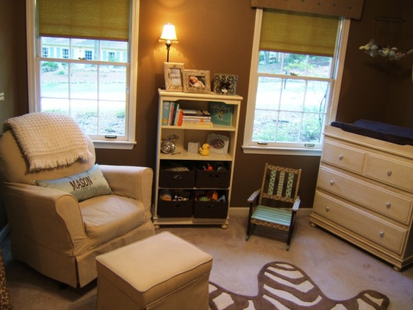 "Baby Boy's Jungle Room, This boy's nursery was also done on a budget. I chose my fabrics first and decided to go with chocolate brown and a robin's egg blue (which morphed into more of an aqua). Initially I wasn't sure of a ""theme"" but knew that I wanted a rustic feel. The zebra rug, sock monkey, and giraffe display made it obvious that subconciously I had chosen a jungle theme =)  Here is the furniture cost breakdown: Convertible Dropside Crib @ Target.com.....$125 Changing Dresser @ JC Penney.....$170 Bookshelves @ JC Penney.....$100 Dutailier Glider & Ottoman (a splurge!) @ Albee Baby.....$570 Rug @ Target.com.....$53  With much planning and a tremendous amount of help from Gigi (my mom), this room has come to be one of my favorites. Hope you enjoy!, The windows give a view of the front yard and it's very sunny during the daytime.     , Nurseries Design"
