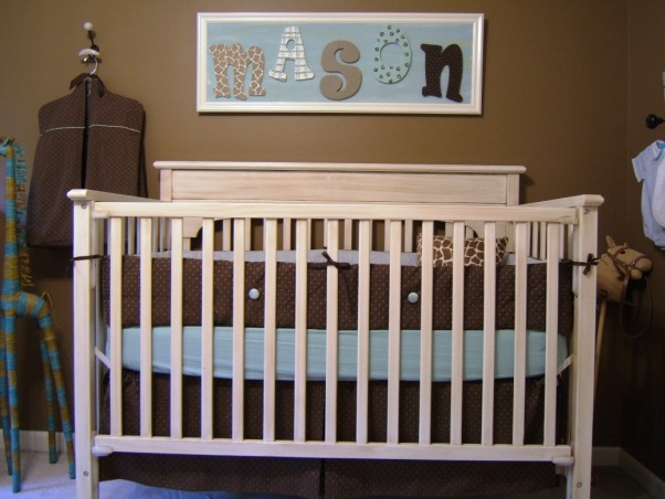 "Baby Boy's Jungle Room, This boy's nursery was also done on a budget. I chose my fabrics first and decided to go with chocolate brown and a robin's egg blue (which morphed into more of an aqua). Initially I wasn't sure of a ""theme"" but knew that I wanted a rustic feel. The zebra rug, sock monkey, and giraffe display made it obvious that subconciously I had chosen a jungle theme =)  Here is the furniture cost breakdown: Convertible Dropside Crib @ Target.com.....$125 Changing Dresser @ JC Penney.....$170 Bookshelves @ JC Penney.....$100 Dutailier Glider & Ottoman (a splurge!) @ Albee Baby.....$570 Rug @ Target.com.....$53  With much planning and a tremendous amount of help from Gigi (my mom), this room has come to be one of my favorites. Hope you enjoy!, Although he only uses it for day naps, here's Mason's crib. Gigi also antiqued the bookshelves, dresser, and crib to match and give a great rustic feel to the furniture.   , Nurseries Design"