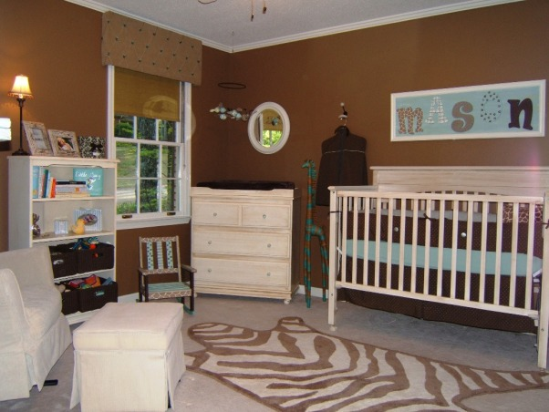 "Baby Boy's Jungle Room, This boy's nursery was also done on a budget. I chose my fabrics first and decided to go with chocolate brown and a robin's egg blue (which morphed into more of an aqua). Initially I wasn't sure of a ""theme"" but knew that I wanted a rustic feel. The zebra rug, sock monkey, and giraffe display made it obvious that subconciously I had chosen a jungle theme =)  Here is the furniture cost breakdown: Convertible Dropside Crib @ Target.com.....$125 Changing Dresser @ JC Penney.....$170 Bookshelves @ JC Penney.....$100 Dutailier Glider & Ottoman (a splurge!) @ Albee Baby.....$570 Rug @ Target.com.....$53  With much planning and a tremendous amount of help from Gigi (my mom), this room has come to be one of my favorites. Hope you enjoy!, Nurseries Design"