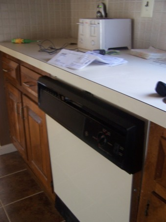 redo-painted my laminate countertops to look like granite!!!, Ok, so i have had 3 attempts at my living room color...but my kitchen is on the 5th color in the last 5 months and i am sure there is no right color for this kitchen! I need help. I love neutrals and earth tones but i have no idea how to make this horrible kitchen work., this is my dishwasher that gets the dishes more filthy than before i put them in to be cleaned. i use it now as a oversized drying rack.   , Kitchens Design