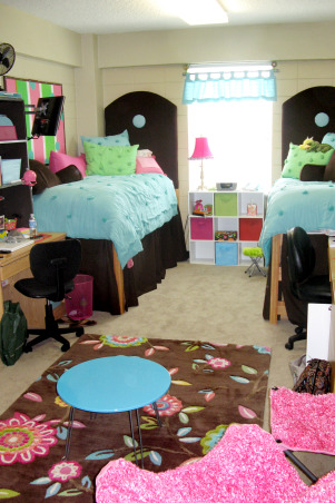 "Girls Dorm Room-Fun & Functional with homemade headboards, Your typical dorm room with the drab block walls that we aren't allowed to paint.... as moms we all try to create that home away from home feeling for our children leaving the nest!!  Of course, those 1st pics of ""our"" creation for them is the only time it will look great! - Neat & clean, etc.!  So these were taken on moving day!  We made matching headboards & my talented mother pitched in on the sewing of the dustruffles!  The comforter & pillows I got from PB teen! - Along with the splurge on the rug (which was actually the inspiration for the room!)  We had the old bulletin board & painted that to match.   Our daughter loved her ""new"" room!, Finally the rug came in!!  They cleaned up the room before I got there!!!!  , Dorm Rooms Design"
